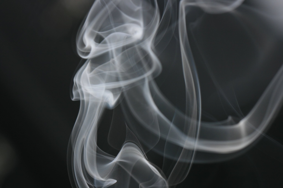 An extremely close up image of wisps of smoke